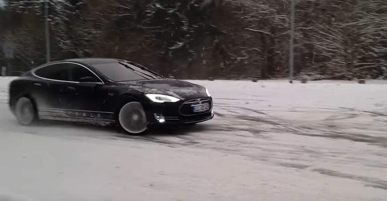 Tesla model S drifting on the snow